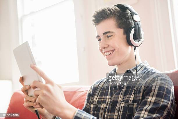 Happy Boy Listening Music Through Digital Tablet