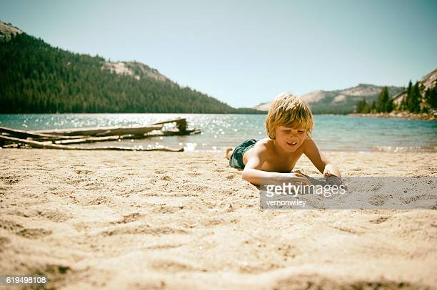 Happy boy on beach in Yosemite Ca