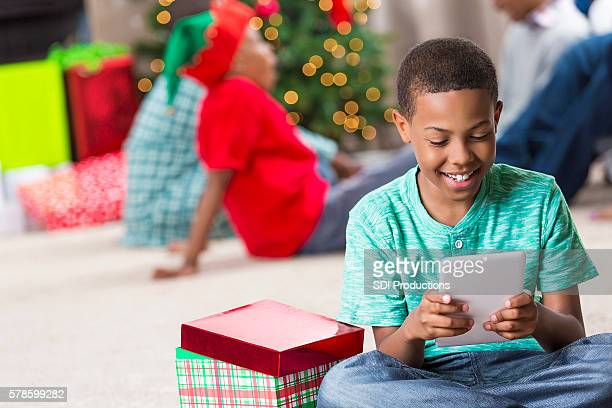 Happy boy receives tablet at Christmastime