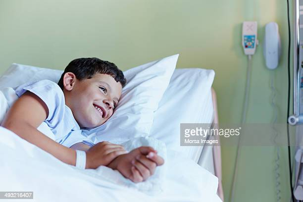 Happy boy relaxing in hospital ward