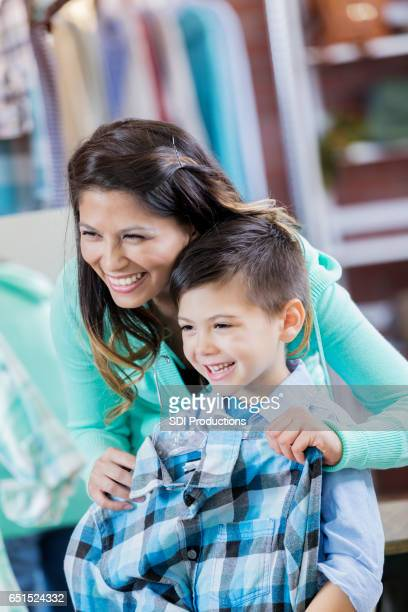 Happy boy smiles while shopping with his mom