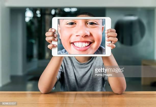 Happy boy taking self portrait