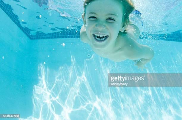 Happy boy underwater