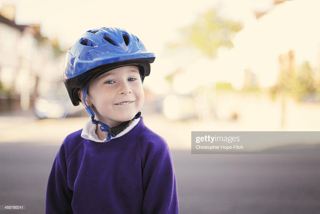 Happy boy wearing a cycle helmet