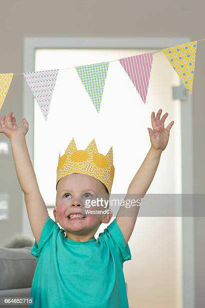 Happy boy wearing paper crown