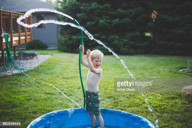Happy Boy With Garden Hose