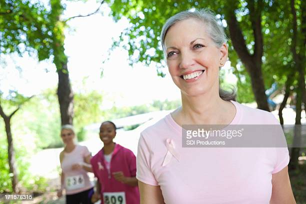 Happy breast cancer survivor completing charity race