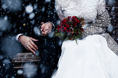 Happy bride and groom enjoying romantic moments outdoors. Wedding couple.Winter concept.