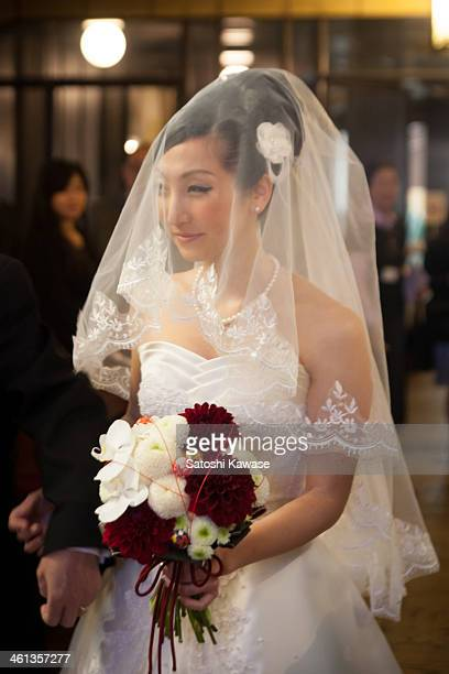 Happy bride entering the chapel with her father