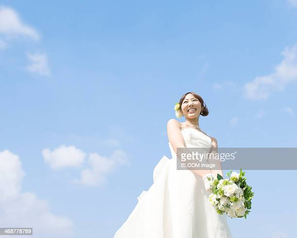 Happy Bride Holding Bouquet