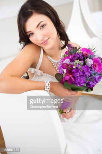 Happy bride sitting on chair