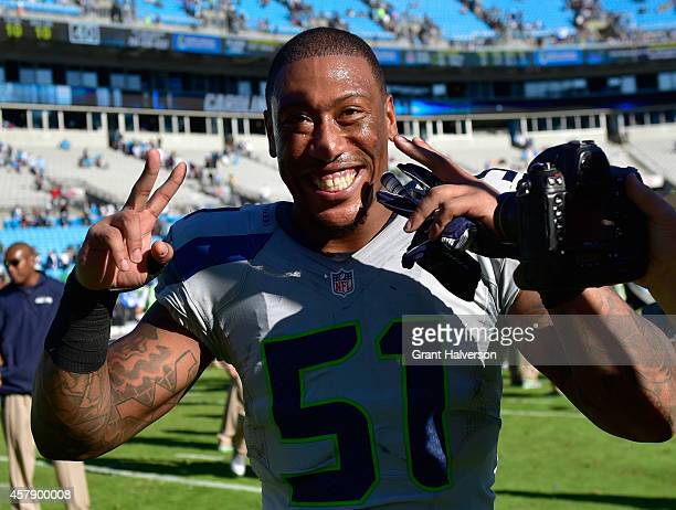 A happy Bruce Irvin of the Seattle Seahawks leaves the field after a win over the Carolina Panthers at Bank of America Stadium on October 26 2014 in...