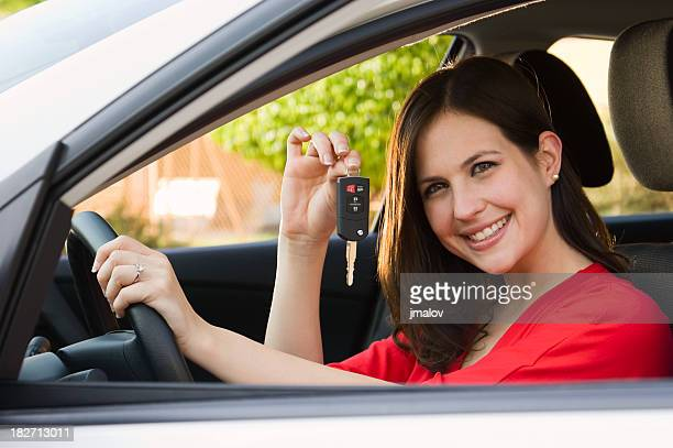 Happy Brunette with New Car