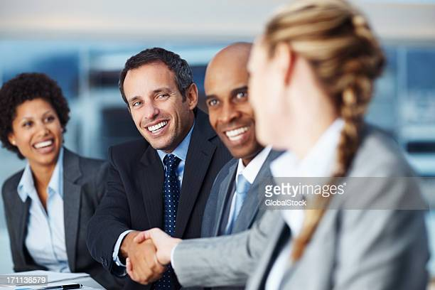 Happy business colleagues shaking hands