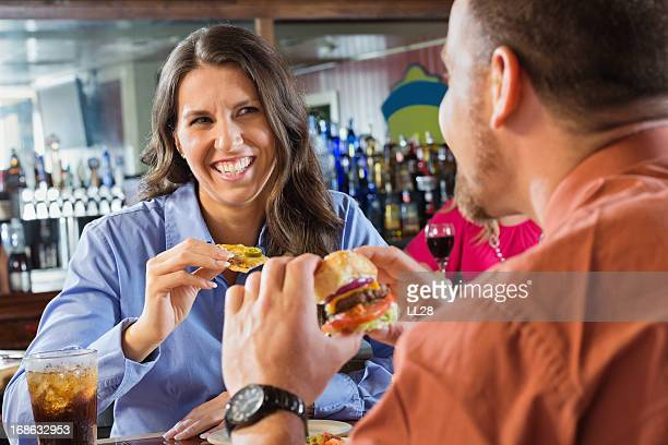 Happy Business Couple At Restaurant