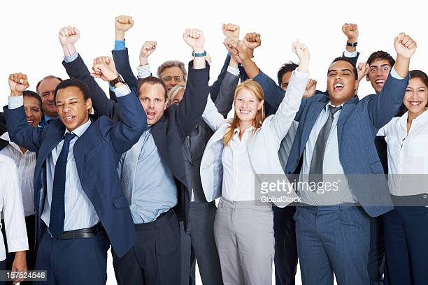 Happy business executives with hands raised in excitement