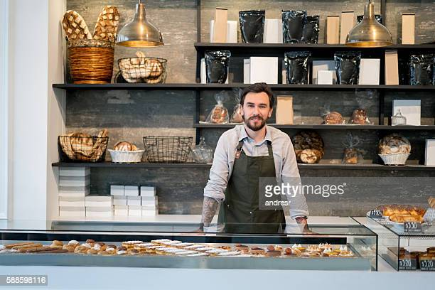 Happy business owner at a bakery