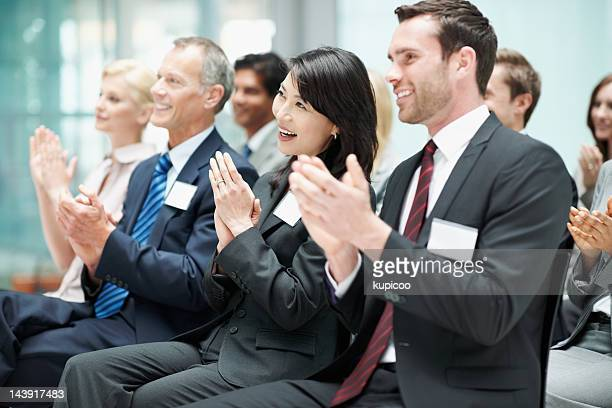 Happy business people clapping after good presentation