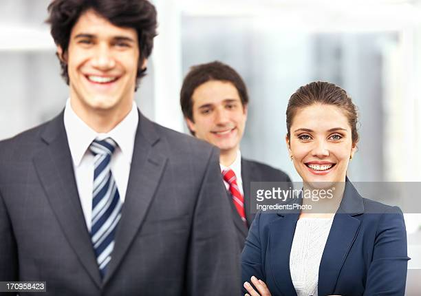 Happy business team at their workplace in the office.