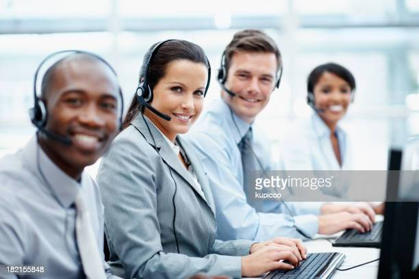 Happy business team working in a call center