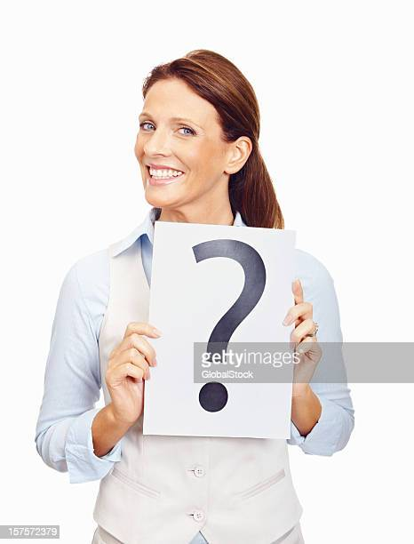 Happy business woman holding a question mark sign on white