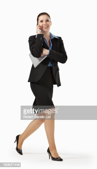 Happy business woman running whilst on smart phone : Stockfoto