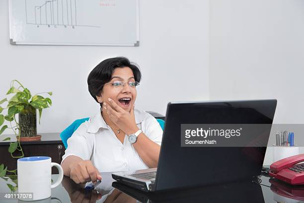 Happy business woman Surprised with some Good News