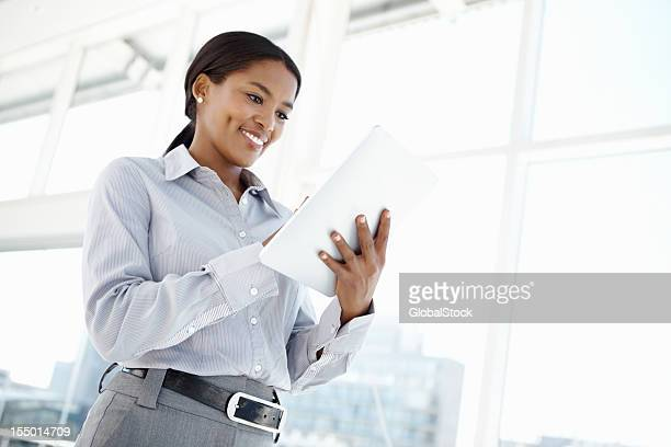 Happy business woman using touchpad PC