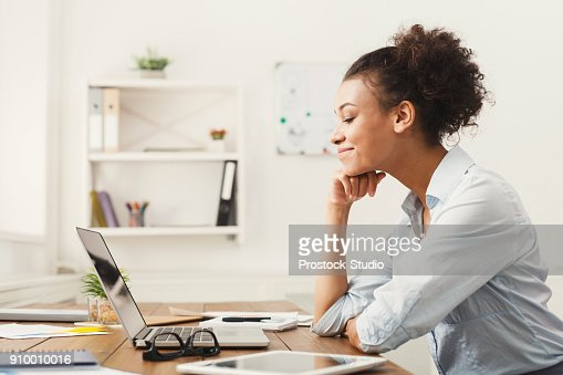 Happy business woman working on laptop at office : Stock Photo