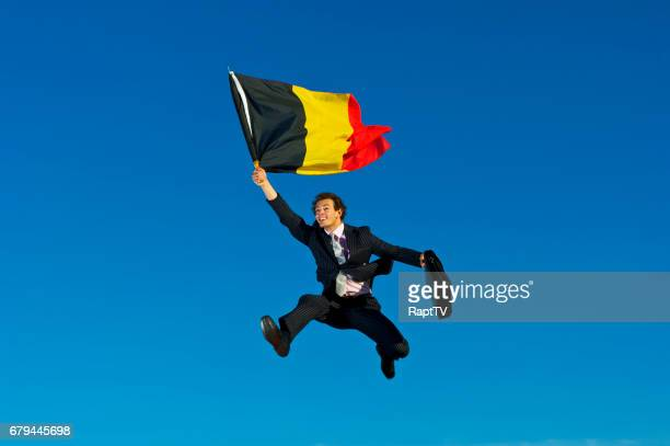A Happy Businessman Flying the Flag for Belgium.