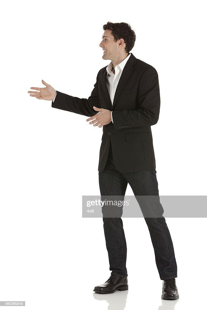 Happy businessman gesturing