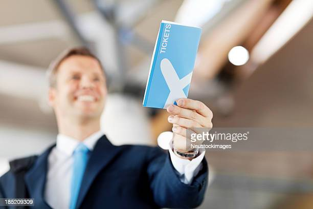 Happy Businessman Handing Over His Flight Tckets