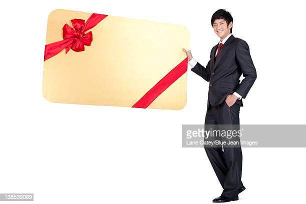 Happy Businessman Holding an Oversized Wrapped Card