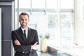 Happy businessman in an office