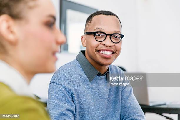Happy businessman in creative office
