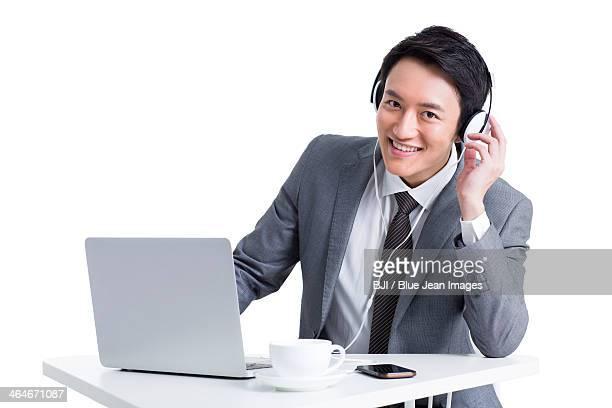 Happy businessman listening to music