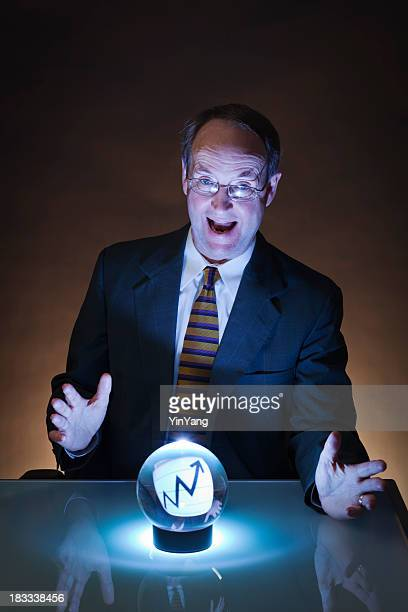 Happy Businessman Looking into Crystal Ball for Future Investment Gain