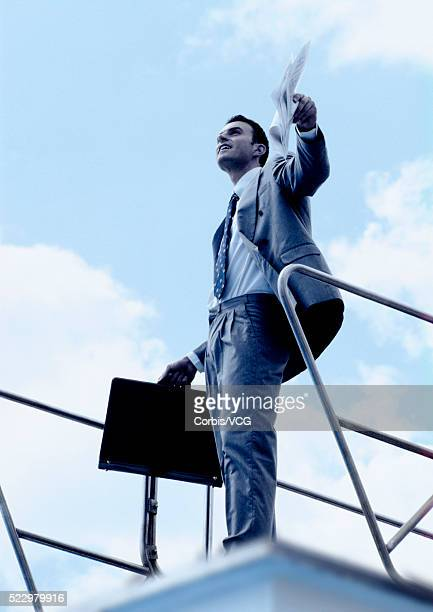 Happy Businessman on Diving Platform