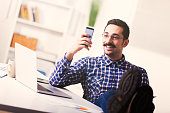 Happy businessman reading a text message on mobile phone