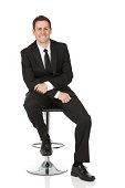 Happy businessman sitting on a chair