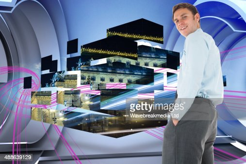 Composite image of happy businessman standing with hands in pockets : Stock-Foto