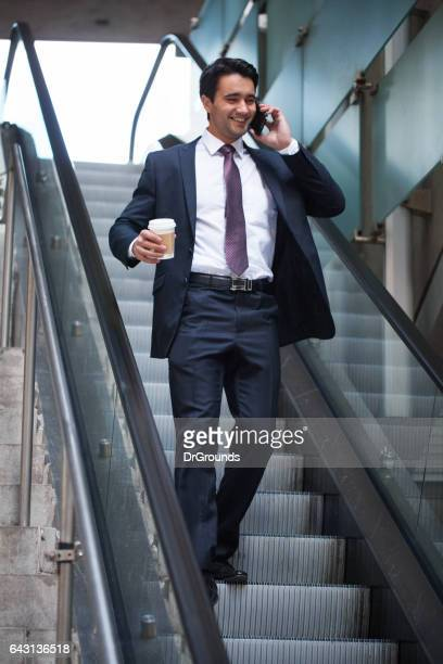 Happy businessman talking on phone