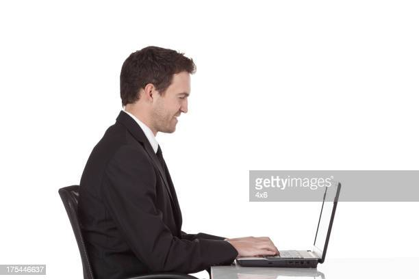 Happy businessman using a laptop