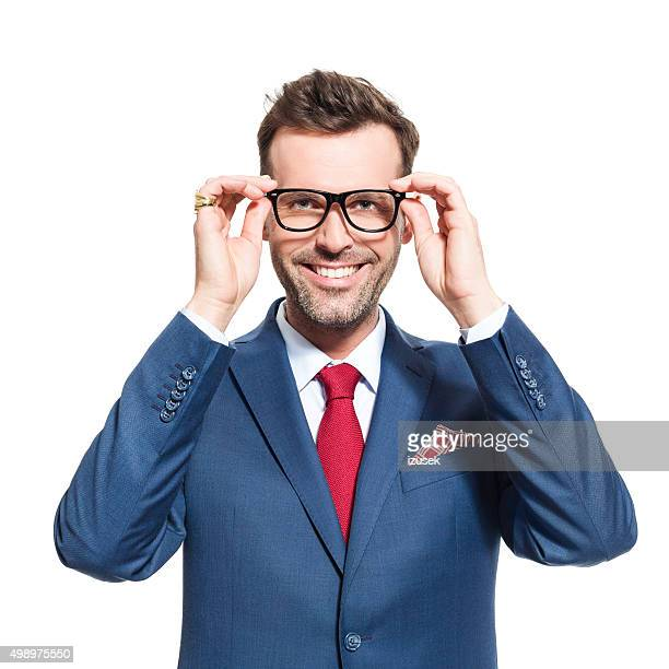 Happy businessman wearing suit and nerd glasses
