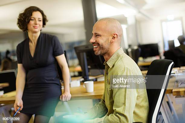 Happy businessman with colleague during break