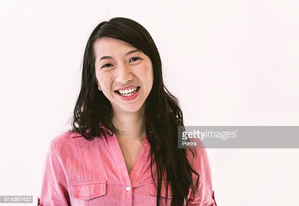 Happy businesswoman against white background