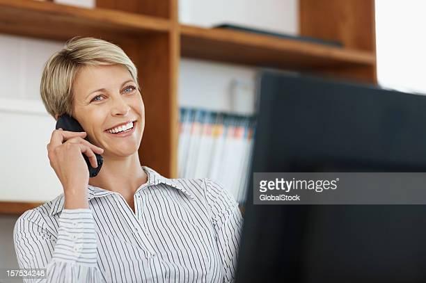 Happy businesswoman having a conversation over cellphone
