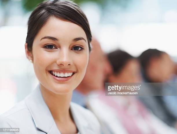 Happy businesswoman in a meeting with colleagues