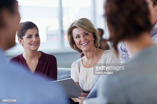 Happy businesswoman in meeting