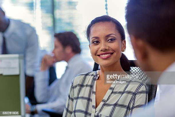 Happy businesswoman in meeting with colleague